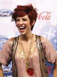"<p>Performer Lacey Brown poses at the party for the 12 finalists of the television show ""American Idol"" in Los Angeles March 11, 2010. REUTERS/Mario Anzuoni</p>"