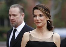 <p>Actress Sandra Bullock and husband Jesse James arrive at the 41st Annual NAACP Image Awards in Los Angeles, February 26, 2010. REUTERS/Danny Moloshok</p>