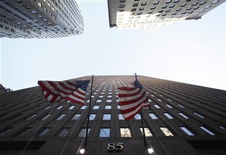Flags fly outside of the Goldman Sachs headquarters building in the financial district of New York January 21, 2010. REUTERS/Jessica Rinaldi