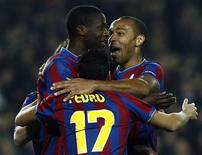 <p>Barcelona's Pedro Rodriguez (C) celebrates with team mates Yaya Toure (L) and Thierry Henry after scoring against VfB Stuttgart during their Champions League last 16, second leg soccer match at the Camp Nou stadium in Barcelona March 17, 2010. REUTERS/Albert Gea</p>