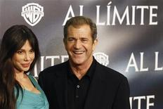 "<p>Actor Mel Gibson (R) and Oksana Grigorieva pose during the Spanish premiere of the film ""Edge of Darkness"" in Madrid February 1, 2010. REUTERS/Juan Medina</p>"