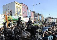 <p>The funeral cortege for Malcolm McLaren passes through Camden, in north London April 22, 2010. REUTERS/Toby Melville</p>