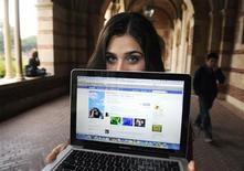 <p>A woman displays her page on the social networking site Facebook, while attending school in Los Angeles January 26, 2010. REUTERS/Phil McCarten</p>