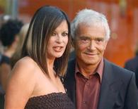 <p>Vidal Sassoon (R) poses with his wife Ronnie as they arrive the opening of the first Stella McCartney boutique in Los Angeles September 28, 2003. REUTERS/Jim Ruymen</p>