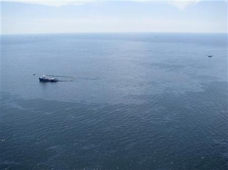 Response boats work to clean up oil where the Deepwater Horizon oil rig sank, off Louisiana in this April 22, 2010 handout photo. REUTERS/U.S. Coast Guard/Handout