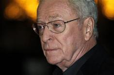 "<p>British actor Michael Caine poses for photographers as he arrives for the European premiere of the movie ""Harry Brown"" in London, November 10, 2009. REUTERS/Kevin Coombs</p>"
