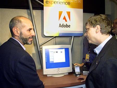Bill Gates (R), chairman and chief software architect of Microsoft, listens to Bruce Chizen, president and CEO of Adobe, as he explains new features of Adobe products at the Microsoft Windows XP partner pavilion October 24, 2001 in New York. REUTERS/Jeff Christensen