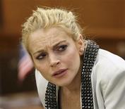 <p>Actress Lindsay Lohan attends a progress report hearing for her 2007 drunk driving case at a courthouse in Beverly Hills, California October 16, 2009. REUTERS/Nick Ut/Pool</p>