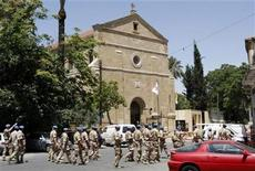 <p>United Nations personnel walk in front of the Franciscan monastery, where Pope Benedict XVI will be staying during his visit to Cyprus, in Nicosia June 1, 2010. REUTERS/Andreas Manolis</p>