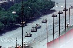 <p>A man stands passively to block a column of army tanks on Changan Avenue east of Tiananmen Square in Beijing in this June 5, 1989 file photo. REUTERS/Arthur Tsang/Files</p>