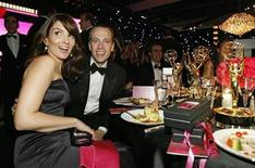 <p>Actress Tina Fey and a guest attend the Governor's Ball at the 60th annual Primetime Emmy Awards in Los Angeles September 21, 2008. REUTERS/Mario Anzuoni</p>