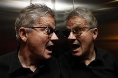 <p>Mark Mothersbaugh, lead singer of the U.S. band Devo, poses for a photograph in a hotel elevator in London June 9, 2010. REUTERS/Stefan Wermuth</p>