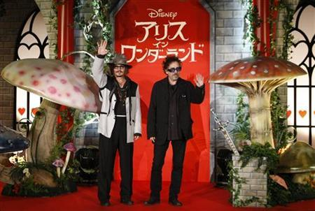 Actor Johnny Depp (L) and Director Tim Burton pose at an event to promote the movie ''Alice in Wonderland'' in Tokyo March 22, 2010. REUTERS/Kim Kyung-Hoon