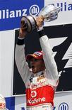 <p>O piloto da MacLaren Lewis Hamilton venceu o Grande Prêmio do Canadá neste domingo, e assumiu a liderança do campeonato de Fórmula 1. 13/06/2010 REUTERS/Mathieu Belanger</p>