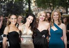 "<p>(From L-R) Actresses Sarah Jessica Parker, Kristin Davis, Kim Catrall and Cynthia Nixon pose for photographers at the premiere of their new film ""Sex and the City 2"" in Leicester Square, London May 27, 2010. REUTERS/Kieran Doherty</p>"