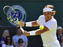<p>Spain's Rafael Nadal hits a return to Japan's Kei Nishikori at the 2010 Wimbledon tennis championships in London, June 22, 2010. REUTERS/Toby Melville</p>