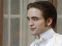 "<p>British actor Robert Pattinson is seen during the filming of a scene in his new movie ""Bel Ami"" in Budapest April 8, 2010. REUTERS/Karoly Arvai</p>"