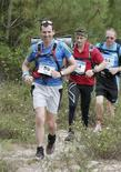 <p>Paul Carrel (L) leads a British contingent into Hourtin, near France's Atlantic coast, at the end of Stage 1 on the 6-day Trans Aq ultramarathon, May 31, 2010. Picture taken May 31, 2010. REUTERS/Dunes Organisation/Handout</p>