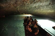 <p>Tourists tour the lower cave of the Jeita Grotto by boat June 12, 2010. REUTERS/Jamal Saidi</p>