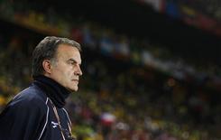 <p>Técnico do Chile Marcelo Bielsa considerou eliminação pelo Brasil justa, mas o placar de 3 x 0, não. REUTERS/Kai Pfaffenbach</p>