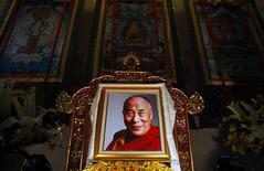 <p>A picture of exiled Tibetan spiritual leader, the Dalai Lama, is placed outside the venue of a performance celebrating his 75th birthday in Taipei July 6, 2010. REUTERS/Nicky Loh</p>