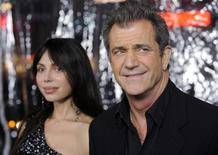 """<p>Cast member Mel Gibson (R) and Oksana Grigorieva attend the premiere of the film """"Edge of Darkness"""" in Los Angeles January 26, 2010. REUTERS/Phil McCarten</p>"""