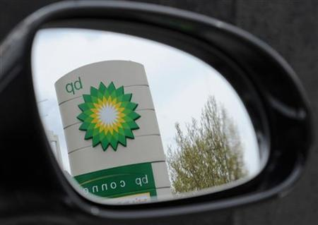 A British Petroleum (BP) logo is seen reflected in a car mirror at a petrol station in south London April 27, 2010. REUTERS/Toby Melville