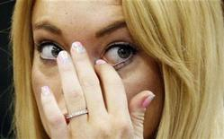 <p>Actress Lindsay Lohan rubs her eye as she appears in court during a probation status hearing relating to her August 2007 no contest pleas to two counts each of DUI and being under the influence of cocaine, along with a reckless driving charge, at the Beverly Hills Municipal Courthouse, California, July 6, 2010. REUTERS/David McNew/Pool</p>
