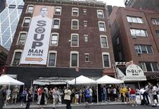 <p>People stand in line outside The Original SoupMan location at 55th street and 8th avenue for its reopening in New York July 20, 2010. REUTERS/Shannon Stapleton</p>