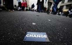 """<p>A crowd of people makes its way down a street behind a card that reads """"America Wants Change"""" in Washington, January 20, 2009. REUTERS/Mark Blinch</p>"""