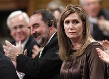 <p>Canada's Minister of State for Status of Women Helena Guergis (R) receives a standing ovation while speaking during Question Period in the House of Commons on Parliament Hill in Ottawa March 17, 2010. REUTERS/Chris Wattie</p>