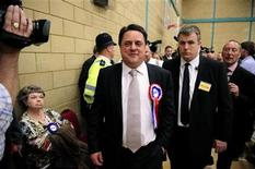 <p>British National Party leader Nick Griffin leaves the result of the Local Council election vote count for the constituency of Barking in Dagenham, southern England May 7, 2010. REUTERS/Kieran Doherty</p>