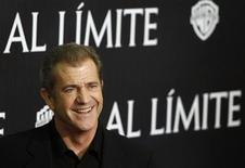 """<p>Actor Mel Gibson poses during the Spanish premiere of the film """"Edge of Darkness"""" in Madrid February 1, 2010. REUTERS/Juan Medina</p>"""