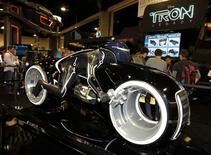 "<p>A replica motorcycle from Disney's new movie ""Tron: Legacy"" is displayed during Comic Con in San Diego, California July 22, 2010. REUTERS/Mike Blake</p>"