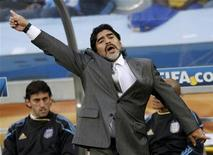 <p>Argentina's coach Diego Maradona gestures during their 2010 World Cup quarter-final soccer match against Germany at Green Point stadium in Cape Town July 3, 2010. REUTERS/Darren Staples</p>