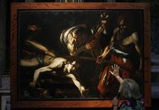 "<p>Rosella Vodret (R) of Rome's Museums Authority speaks about the ""Martyrdom of St. Lawrence"" painting as it is displayed at Chiesa del Gesu (Church of the Holy Name of Jesus) in Rome July 27, 2010. REUTERS/Alessandro Bianchi</p>"