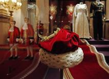 <p>Britain's Queen Elizabeth's Cap of Maintenance, used at the State Opening of Parliament is displayed at Buckingham Palace in London July 23, 2010. REUTERS/Suzanne Plunkett</p>