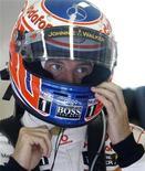 """<p>Jenson Button da McLaren durante treino livre para o GP da Hungria em Hungaroring.O campeão mundial condenou as """"ordens de equipe"""" na Fórmula 1 e disse que poderia deixar o esporte se não houver mais uma disputa limpa entre os pilotos. 30/07/2010 REUTERS/Leonhard Foeger</p>"""