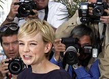 """<p>Cast member Carey Mulligan arrives at a photocall for the film """"Wall Street - Money Never Sleeps"""" by U.S. director Oliver Stone during the 63rd Cannes Film Festival in Cannes May 14, 2010. REUTERS/Jean-Paul Pelissier</p>"""