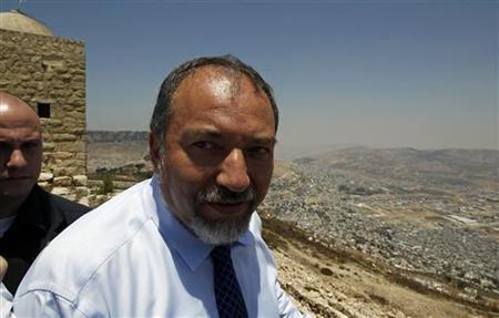 Israel's Foreign Minister Avigdor Lieberman visits Mount Gerizim near the West Bank city of Nablus July 26, 2010. REUTERS/Ronen Zvulun