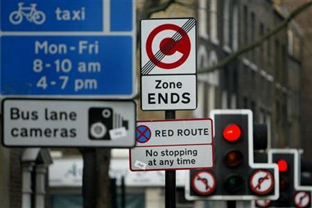 A new road sign (2L) stands amongst other traffic signs on Farringdon Road, London, January 24 2003. REUTERS/Toby Melville