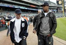 <p>Music entertainers Eminem (L) and Jay-Z walk on the field of Comerica Park before the start of the MLB game between the New York Yankees and Detroit Tigers, in Detroit, Michigan May 12, 2010. REUTERS/Rebecca Cook</p>