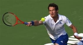 <p>Andy Murray of Britain hits a return to Roger Federer of Switzerland during their final match at the Rogers Cup tennis tournament in Toronto August 15, 2010. REUTERS/Peter Jones</p>