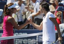 <p>Francesca Schiavone (R) of Italy shakes hands with Ayumi Morita of Japan after Schiavone won their match during the U.S. Open Tennis Tournament in New York August 30, 2010. REUTERS/Eduardo Munoz</p>