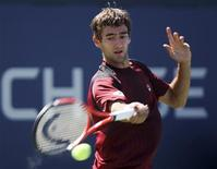 <p>Marin Cilic of Croatia hits a return to Illya Marchenko of Ukraine during the U.S. Open in New York August 30, 2010. REUTERS/Kena Betancur</p>