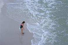 <p>A swimmer stands at the edge of the surf on Pensacola Beach, Florida, June 4, 2010. REUTERS/Colin Hackley</p>