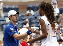 <p>Andy Murray of Britain (L) is congratulated by Dustin Brown after their match during the U.S. Open tennis tournament in New York, September 3, 2010. REUTERS/Kevin Lamarque</p>