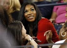 <p>Injured tennis player Serena Williams watches her older sister Venus Williams serve to Mandy Minella of Luxembourg during the U.S. Open tennis tournament in New York September 3, 2010. REUTERS/Shannon Stapleton</p>