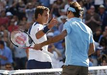 <p>Paul-Henri Mathieu (L) of France congratulates Roger Federer of Switzerland during the US Open tennis tournament in New York, September 4, 2010. REUTERS/Jessica Rinaldi</p>