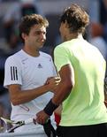 <p>Rafael Nadal (R) of Spain shakes hands with Gilles Simon of France after Nadal won their match at the U.S. Open tennis tournament in New York, September 5, 2010. REUTERS/Kevin Lamarque</p>